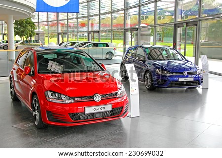 WOLFSBURG, GERMANY - AUGUST 14, 2014: Modern compact cars Volkswagen Golf in the trade center of the Volkswagen Autostadt. - stock photo