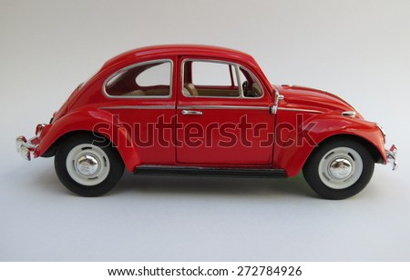 WOLFSBURG, GERMANY - CIRCA APRIL 2015: Miniature Representation of Volkswagen Type-1 aka Classical Beetle from 1967, produced as a children's toy in China, circa 2008 - stock photo