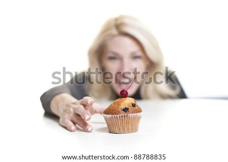 Woman about to eat cake - stock photo