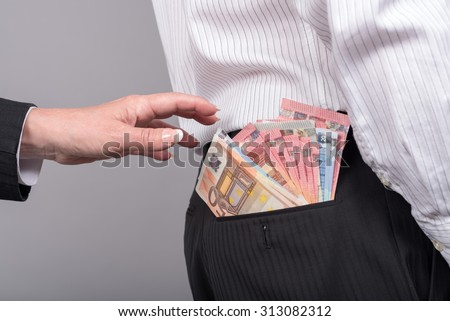 Woman about to take money out of back pocket of a businessman