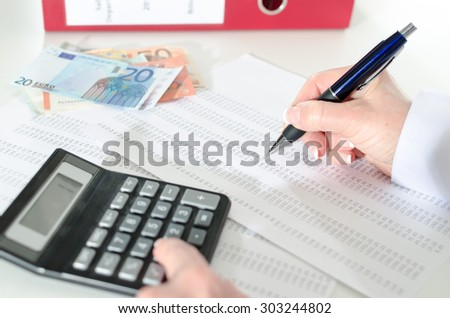 Woman accountant working on financial results