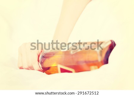 Woman addiction to strong acohol - stock photo
