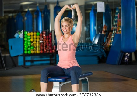 Woman aerobic exercise fitness using weight dumbbell for toned arms and posture - stock photo