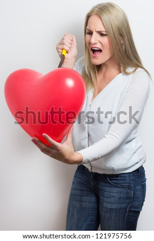 Woman after break up very angry and screaming - stock photo