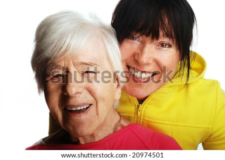 woman aged and young girl laughing - stock photo