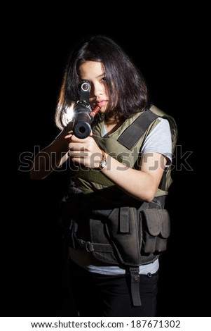 Woman aiming a rifle isolated on black background. - stock photo