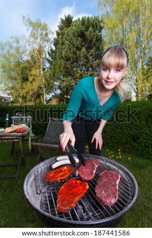 woman and a barbecue  - stock photo