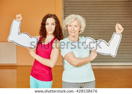 Woman and active senior with muscles at fitness center - stock photo