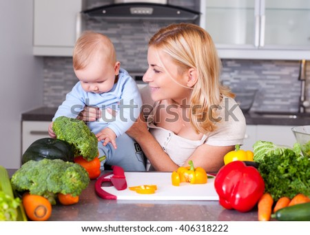 Woman and baby in the kitchen