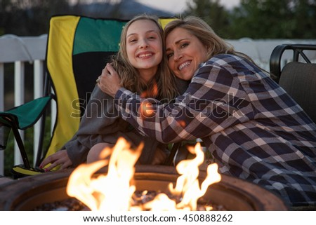 woman and child at camp fire - stock photo