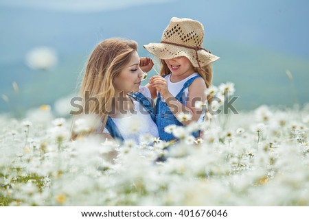 Woman and child in nature - stock photo