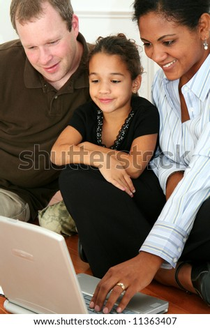 Woman and daughter on the computer - stock photo