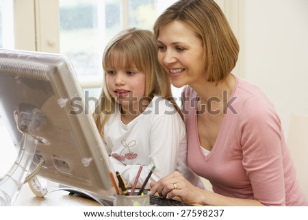 Woman And Daughter Using Computer - stock photo