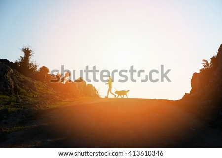 Woman and dog walking - stock photo
