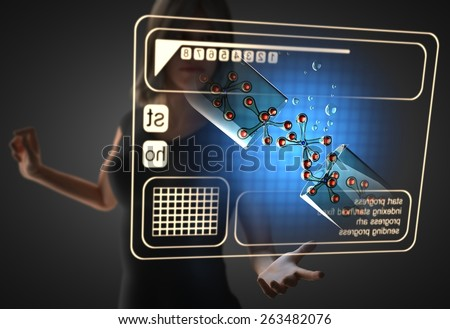 woman and futusistic hologram on hand - stock photo