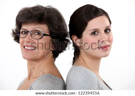 Woman and her adult daughter - stock photo
