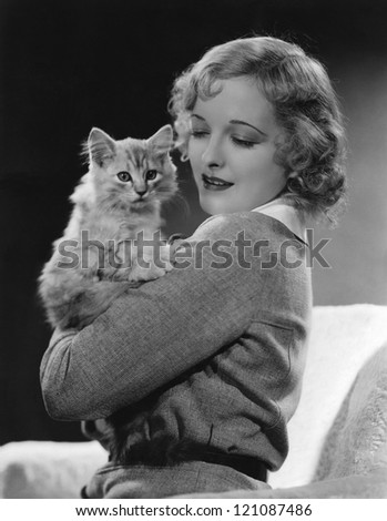 Woman and her cat - stock photo