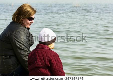 Woman and her daughter at Lake Balaton, Hungary - stock photo