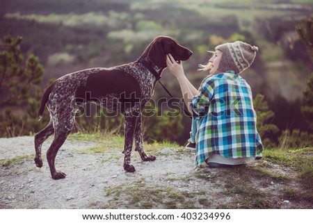 Woman and her dog posing outdoor. Active lifestyle with dog.  - stock photo