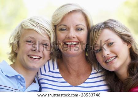 Woman And Her Teenage Children - stock photo
