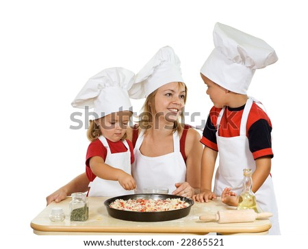 Woman and kids dressed as chefs preparing pizza - isolated - stock photo