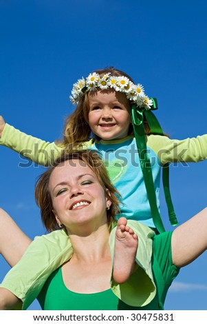 Woman and little girl enjoying the spring sun