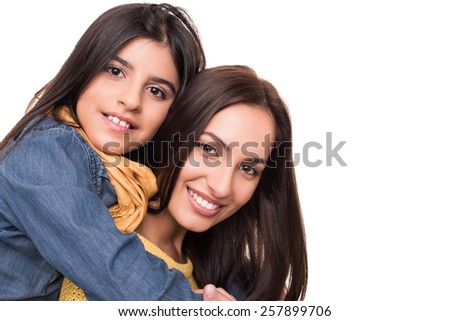 Woman and little girl hugging each other - Family concept
