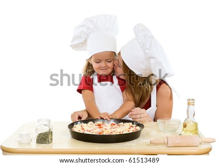 Woman and little girl making pizza together - isolated - stock photo