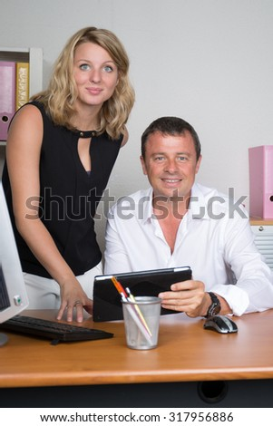 Woman and man at business with a tablet