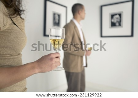 Woman and Man at Gallery Opening - stock photo