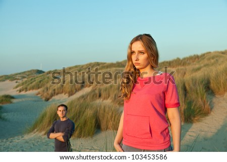 woman and man at the beach - stock photo