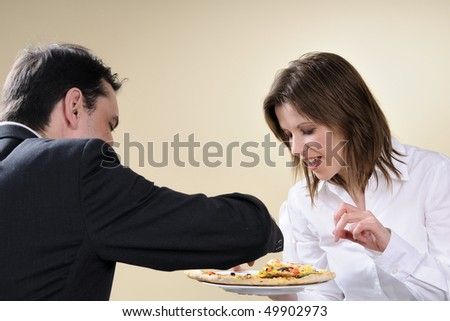 woman and man eating pizza - stock photo