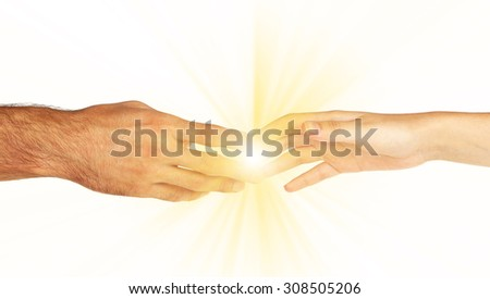 Woman and man hand attracted to each other with light isolated on white - stock photo
