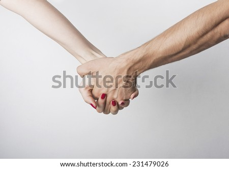 Woman and man hand in hand