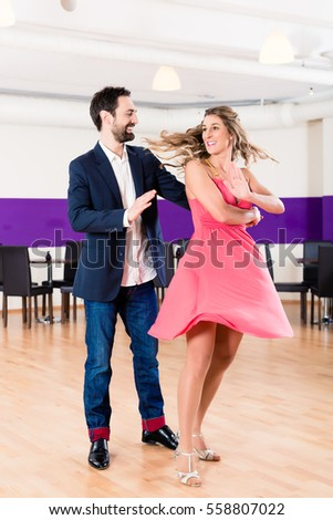 Woman and man in dance school learning