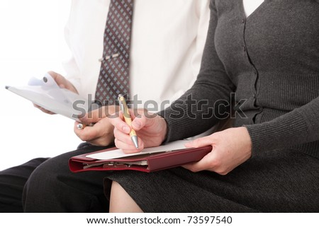 woman and man in grey write by pen on paper. Businesswoman signs. Isolated on white background