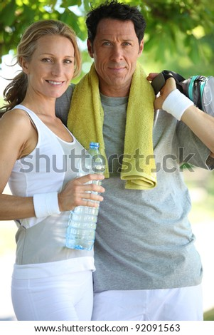 woman and man in sports clothes - stock photo