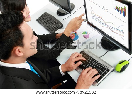 woman and man office worker working on computer in the office - stock photo