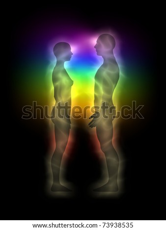 Woman and man silhouette with aura, chakras, energy - profile - stock photo
