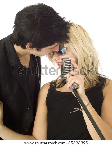 Woman and man singer in garage band isolated on white - stock photo