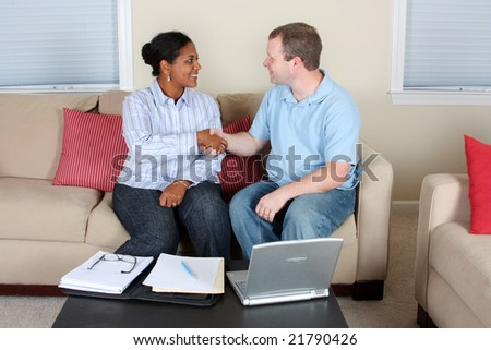 Woman and man sitting at the computer a her home