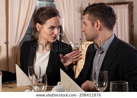 Woman and man talking in a restaurant