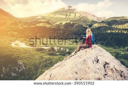 Woman and Man Travelers relaxing on summit hiking Travel Lifestyle concept Summer vacations outdoor aerial view forest mountains on background - stock photo