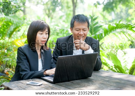 Woman and man use in park - stock photo