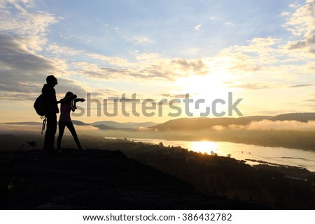 woman and man with sunrise