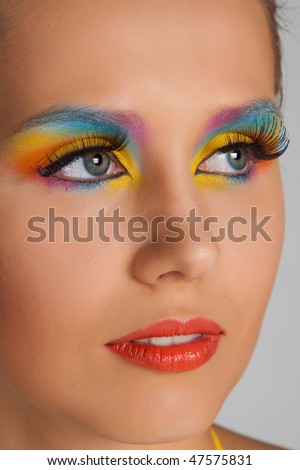 Woman and multicolored make-up. Closeup.
