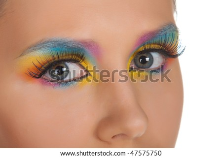 Woman and multicolored make-up. Isolated on white.