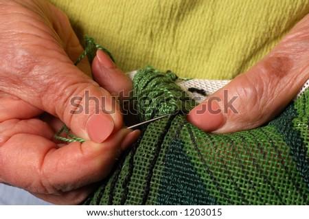 Woman And Needlepoint - stock photo