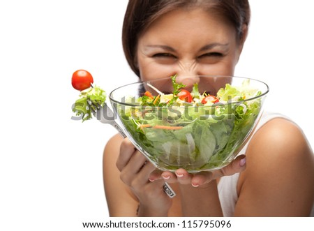 Woman and salad. Focused on salad - stock photo