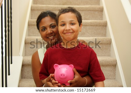 Woman and Son Holding Piggy Bank With Savings - stock photo